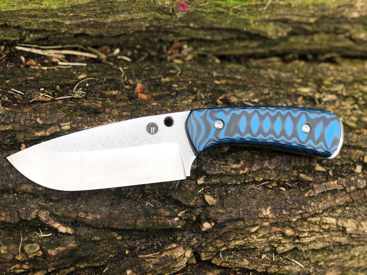 Juggernaut black blue g10 handle